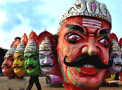 An effigy of demon king Ravana fixed at Azad Maidan ahead of Dussera festival in Mumbai on Sunday. PTI