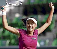 Chang Kai-chen of Taiwan celebrates her first-round win over Russian Dinara Safina on Monday. Reuters