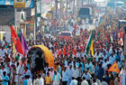festive fervour Hundreds of devotees carrying 'agrodhaka' in a procession on the last day of Dasara Darbar of Rambhapuri seer in Chikmagalur on Monday. DH photo
