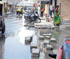 dangerous Drainage and drinking water mixed up due to the overflow of drains on Jumma Masjid Road, Shivajinagar in Bangalore. DH photo