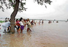 help: People rescuing those who were trapped in Don River near Sarwad village in Bijapur district on Wednesday. DH Photo