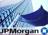 J P Morgan sells unit to top Canadian bank