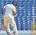 Virender Sehwag looks in disappointment after his stumps were castled by Mumbai's Ajit Agarkar on the opening day of the Irani Cup on Thursday. PTI