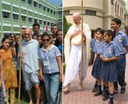 American 'Gandhi' Bernie Meyer (left) and Donald McAvinchey (right) in his Gandhi persona interacting with students in Chandigarh. IANS Photo