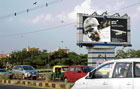 The salesman! A billboard displaying a portrait of Gandhi, besides an image of a Montblanc pen, in New Delhi. AP