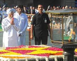 Prime Minister Manmohan Singh pays his respects at Rajghat on Gandhi Jayanti, in New Delhi on Friday. AFP