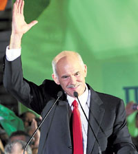 Leader of the Greek Socialist party George Papandreou waves to supporters in Athens on Sunday. ReutersLeader of the Greek Socialist party George Papandreou waves to supporters in Athens on Sunday. Reuters