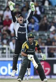 New Zealand wicketkeeper Brendon McCullum celebrates as Pakistan batsman Umar Akmal is dismissed. AP