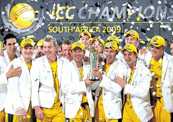 Australian team celebrates after the triumph in the Champions Trophy on Monday night. AP