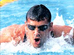 Karnataka's Rehan Poncha created a new meet record in the 200M butterfly at the Senior National Aquatic Championship in Thiruvanthapuram on Tuesday.