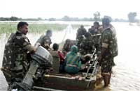 Indian Army's soldiers during a rescue operation of flood-affected villagers in Bagalkot district, Karnataka, Tuesday. PTI
