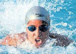 Karnataka's Arhatha Magavi en route to a National record-breaking performance in the 100M butterfly at the Senior National Aquatics Championship on Wednesday in Thiruvananthapuram.