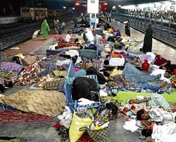 Flood victims take refuge at Kurnool Railway Station on Wednesday. PTI