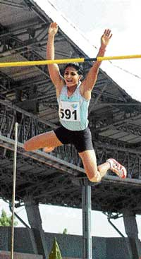 VS Surekha of Railways sails to the pole vault gold in National Athletic Championship on Thursday. PTI