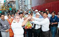 : A crystal bottle of the crude being handed over by DGM (Marine Operations) of Cairn Energy India Ltd Captain S K Pillay and Capt ain of the ship Capt Sashay to MRPL Managing Director U K Basu and Deputy Commissioner V Ponnuraj at NMPT on Friday.