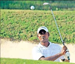C Muniyappa chips from a bunker in the second round of the Indian Open on Friday.