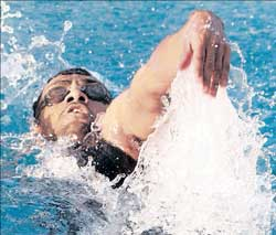 Rehan Poncha storms to victory in the 200M backstroke for his fourth gold at the National Aquatics Championship on Friday.