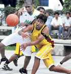 out of my way Mahesh of KSP (right) tries to move past Kevin of HASC in the 'A' Division basketball league in Bangalore on Saturday. DH photo