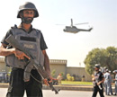 Police commandos take position after an attack on the entrance of army headquarters in Rawalpindi on Saturday. AFP