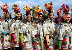 Ladakhi girls, wearing a traditional dress, present a cultural programme during the inaugural function of the Kashmir Festival in Srinagar on Saturday. The dress is typically worn by a community representing the last race of Aryans in the two villages of Ladakh. PTI