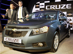 Karl Slym, President and MD, GM India poses with Ankush Arora, Vice President VSSM (L) at the launch of Chevrolet Cruze, in New Delhi on Monday. PTI
