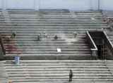 Indian labourers work at the National Stadium in New Delhi