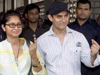 Bollywood actor Aamir Khan along with his wife Kiran coming out after casting votes for the Maharashtra assembly elections, in Mumbai on Tuesday. PTI