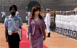 Argentina's President Cristina Fernandez, center, inspects a guard of honor at the Presidential Palace in New Delhi on Wednesday