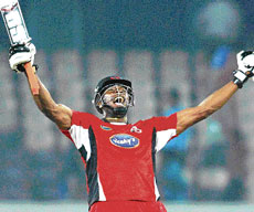 Trinidad's Kieron Pollard celebrates after scoring the winning run against New South Wales at the Rajiv Gandhi International stadium in Hyderabad on Friday. PTI