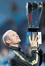 Gutsy show: Russian Nikolay Davydenko with his Shanghai Masters spoils after beating Rafael Nadal on Sunday. Ap