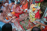 Prior to Theerthodbhava, Priest Ananthakrishnachar and team offering kumkum and flowers to Brahmakundike
