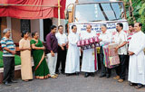 Items of domestic use being handed over to Bellary Bishop Rev Gerald Lobo on behalf of the Mangalore Diocese, following which the Bishop flagged off a truck carrying contributions for the flood victims, at Bishop House in Mangalore on Sunday. DH photo