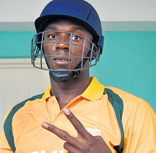 FAST AND FURIOUS: Olympic champion Usain Bolt gets ready to bat at the charity cricket match in Jamaica. AFP