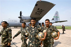 IAF personnel come out af a US C130J aircraft after a training session with their US counterparts at Cope India 09, in Agra on Monday. PTI
