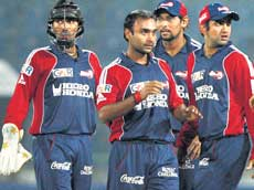 Spinning success: Delhi Daredevils' Amit Mishra (second from left) celebrates with his teammates after dismissing Cape Cobras' JP Duminy on Monday. PTI