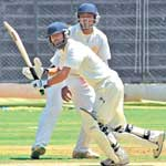 IN FINE FETTLE: J&K's Parvez Rasool flicks during his knock of 68 in the Col CK Nayudu Trophy tie against Karnataka at the Chinnaswamy stadium on Wednesday. DH PHOTO