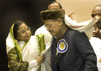 President Pratibha Patil presents a shawl to playback singer Manna Dey, 90, before he was awarded the Dadasaheb Phalke award for the year 2007, during the 55th National Film awards, in New Delhi on Wednesday. The award is given by the Indian government annually for lifetime contribution to Indian cinema. AP