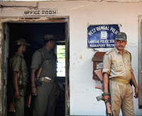 Policeman stands guard at Sankrail Police Station in West Midnapore District on Tuesday. AFP