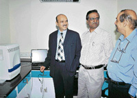 Chairman of Narayana Nethralaya, Dr K Bhujanga Shetty, Commissioner of Health Srinivasachari, Prof and HOD Neurovriology, NIMHANS, Dr V Ravi at H1N1 lab after it was inaugurated in Bangalore on Monday. DH Photo