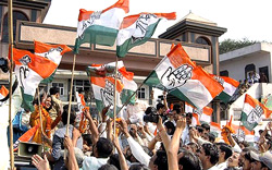 Congress workers celebrate party's win in the Haryana assembly elections in Faridabad on Thursday. PTI
