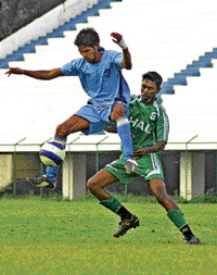 HASC's Satish Kumar (right) tackles Naveen of RWF in the Puttaiah Memorial Cup on Sunday. DH photo