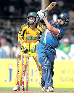 Gautam Gambhir drives James Hopes over long-on during Sunday's first one-dayer. AFP