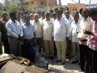 Legislator M Narayanaswamy performing pooja for the Bangarpet-Kolar main road works, in Bangarpet on Monday. Town Municipal Council president Shamsuddin Babu and K Chandra Reddy are seen. DH PHOTO