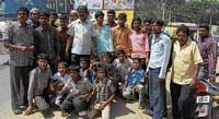 Residents of Phool Sha Mohalla staging a road-blockade, demanding repair of road in Kolar on Monday. DH PHOTO