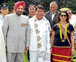 Dorjee Khandu (centre) elected as chief minister of Arunachal Pradesh for the second time, along with Governor J J Singh (left) after the swearing-in ceremony at the Raj Bhawan in Itanagar on Sunday.PTI