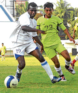 KSP's Kiran Kumar (left) and SAI's Aiyappa battle for possession during their match at the Puttaiah memorial football tournament in Bangalore on Monday. DH photo