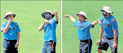 'Can you touch the sky?' Harbhajan seems to ask Sachin Tendulkar during India's training session. 'See I'm going to take off' appears to be the maestro's reply. AFP