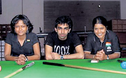 From left: Karnataka cueists Indira Gowda, Pankaj Advani and Chitra Magimairaj strike a pose before leaving for the Asian Indoor Games in Vietnam.