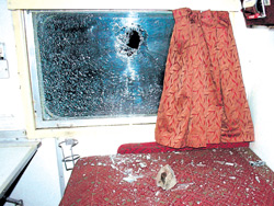 A broken window of the Delhi-Bhubaneswar Rajdhani Express at Banshtala near Jhargram in West Midnapore district on Tuesday PTI