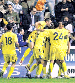 Alcorcon players are jubilant after defeating Real Madrid on Tuesday. REUTERS
